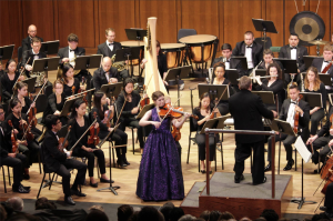 Alice Ping performs the William Walton Viola Concerto with the University of Texas at Austin Orchestra directed by Maestro Gerhardt Zimmermann